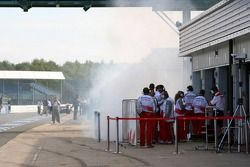 Smoke pitlane outside Toyota Racing