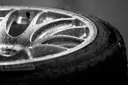 Rain drops on the wheel of a Penske Motorsports Porsche RS Spyder