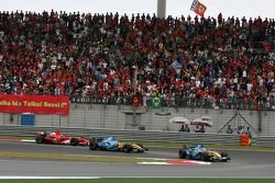 Giancarlo Fisichella leads Fernando Alonso and Michael Schumacher