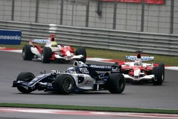 Nico Rosberg leads Jarno Trulli