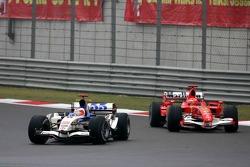 Рубенс Баррикелло, Honda, и Михаэль Шумахер, Ferrari
