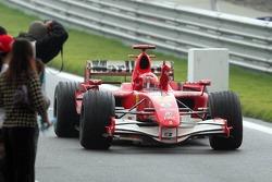 Race winner Michael Schumacher celebrates