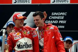 Podium: race winner Michael Schumacher celebrates with Chris Dyer