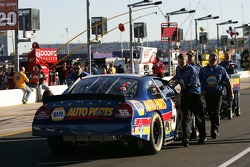 NAPA Dodge crew members push the car to the starting grid