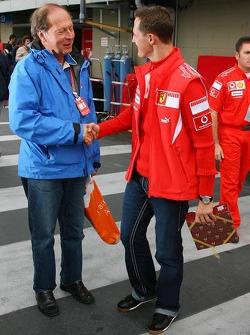 Michael Schumacher receives a gift from a journalist