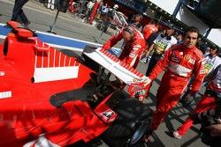 Michael Schumacher's Ferrari i pushed from the garage to scrutineering