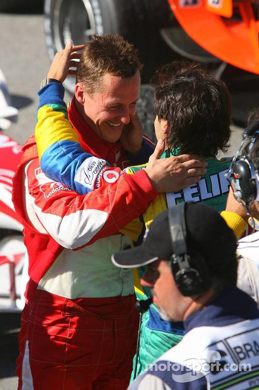 Race winner Felipe Massa congratulated by Michael Schumacher