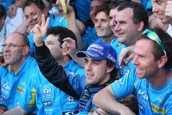 2006 F1 World Champion Fernando Alonso celebrates with Renault F1 team members