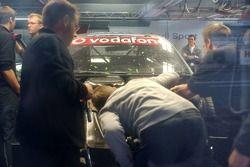 Audi Sport team members work on the damage car of Frank Stippler