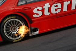Exhaust flames at the car of Jean Alesi