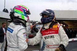 Pole winner Heinz-Harald Frentzen celebrates with Bruno Spengler