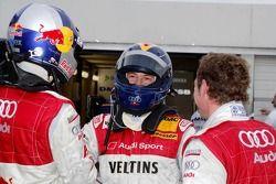 Pole winner Heinz-Harald Frentzen celebrates with Martin Tomczyk and Tom Kristensen