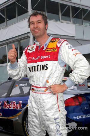 Pole winner Heinz-Harald Frentzen celebrates