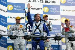A rocketman take the champagne bottle for the race winner to the podium