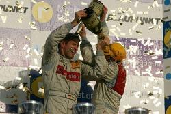 DTM Championship podium 2006: champagne for Bernd Schneider and Tom Kristensen