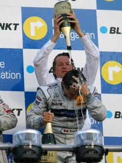 Podium: Bruno Spengler gets a champagne shower from Hans-Jürgen Mattheis