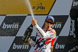 Podium: champagne for Nicky Hayden