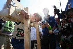 Mikko Hirvonen gets sprayed in the face with champagne