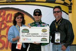 Jeff Gordon poses with check prior