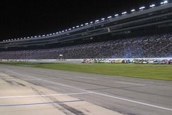 Trucks are gridded on the track before the race