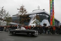 Mercedes-Benz cars drive around the new Mercedes-Benz Museum at Stuttgart-Untertürkheim
