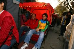 Tuka Rocha takes a ride in a rickshaw with Khalil Beschir