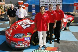 Paul Chive, David Stremme, Reed Sorenson, Juan Pablo Montoya, and Chip Ganassi, stand next to the #42 Big Red Dodge, to be driven in the 2007 season