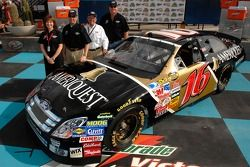 Greg Biffle, Jack Roush and Pat Tryson pose with the AMERIQUEST Ford Fusion that Biffle will campaign in 2007