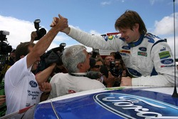 Marcus Gronholm celebrates with BP Ford World Rally team members their win and 2006 World Rally manu
