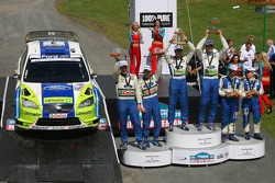 Podium: winners Marcus Gronholm and Timo Rautiainen, with second place Mikko Hirvonen and Jarmo Leht