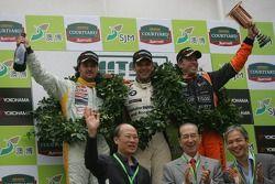 Podium: race winner Jorg Muller with Yvan Muller and Tom Coronel