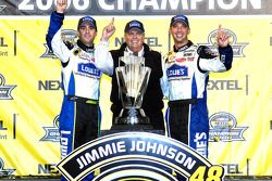 Championship victory lane: 2006 NASCAR Nextel Cup champion Jimmie Johnson celebrates with Rick Hendr