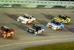 Mike Bliss leads a pack of trucks