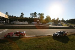 Tommy Archer crosses the finish line while Ron Fellows tries a difficult move