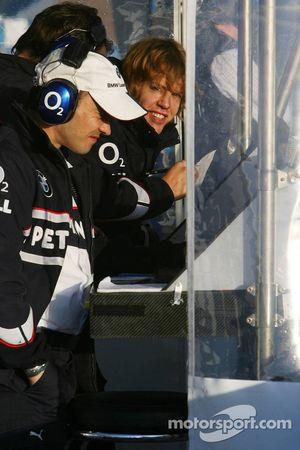 Sebastian Vettel watches on the pitwall