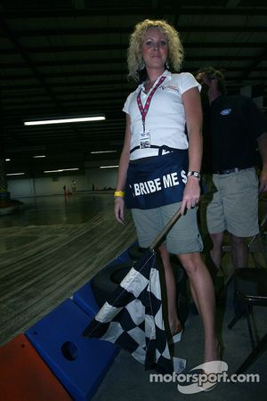 Motorsports Ministries' Jen Anderson about to throw the checkered flag