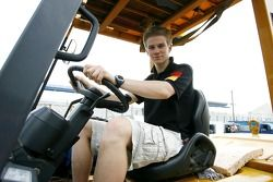 Nico Hulkenberg has fun with a forklift