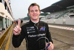 Pole winner Jonny Reid celebrates