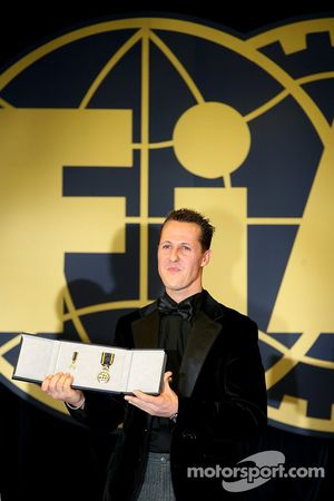 Seven time FIA Formula One World Champion Michael Schumacher with the FIA Academy Gold Medal
