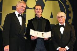 FIA President Max Mosley and FOM President Bernie Ecclestone present Michael Schumacher with the FIA