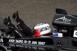 Race winner Jonny Reid celebrates