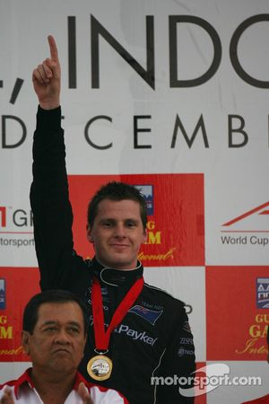 Podium: race winner Jonny Reid celebrates
