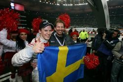 Race of Champions winner Mattias Ekström celebrates with Fredrik Johnsson