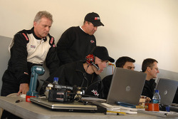 Ricky Rudd and Butch Hylton look over the data gathered from the Robert Yates Racing engineering sta