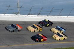 Mike Skinner and Terry Cook lead a pack of trucks
