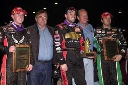 The top three finishers in the 21st Annual O'Reilly Chili Bowl Nationals including winner Tony Stewart (center), runner-up J.J. Yeley (right) and Justin Allgaier (left) are joined by Chili Bowl co-promoters Lanny Edwards (second from left) and Emmett Ha