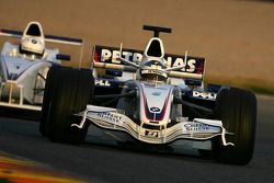 Nick Heidfeld runs ahead a Formula BMW car