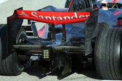Fernando Alonso rolls in the pitlane with the engine off