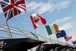 The flags fly over the pits