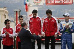 Podium: Prince Albert II of Monaco congratulates winners Sébastien Loeb and Daniel Elena